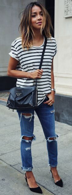 Julie Sarinana is wearing a black and white striped T-shirt from Anine Bing