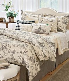 Black and cream - love toile de jouy bedding. Would be cute for a guest room an accent a light blue!