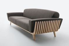 A #sofa from an eco-friendly #furniture company that has a wooden frame resembling a hamper …