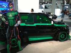 Green Lantern-themed KIA at the 2013 New York International Auto Show. As part of a partnership with Kia Motors, DC Entertainment co-publisher Jim Lee helped design eight cars (though only three were on display at the Auto Show) after Justice League characters Superman, Batman, Wonder Woman, Green Lantern, The Flash, Aquaman, and Cyborg. Kia is also joining DC Entertainment's We Can Be Heroes charity campaign as part of the partnership.