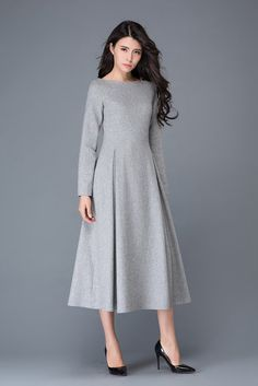 "It is a light gray wool dress it is made of light gray wool, gray polyester lining It has no pockets it is closed by zipper it has pleated on the dress round collar, long sleeve   Shop sizing chart FYI ( made according to US sizing. actual body figures, NOT laying flat clothes measurements)  SIZE (US 0, UK 4, Italian 34, French 32, German 30, Japan 1) bust: fits bust around 32.5"" / 82.5cm Waist: fits waist around 25"" / 64cm Hips: fits hips around 35"" / 89cm For overall height: ..."