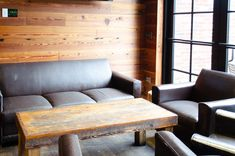 """A single conversation across a table with a wise man is better than ten years of study."" - Henry Wadsworth Longfellow American poet and educator Our Reclaimed Wide Plank Pine skins and table top Want to see more of our specialty millwork? Check out our #linkinbio! #paneling #specialtymillwork Commercial Interior Design, Commercial Interiors, Reclaimed Wood Paneling, American Poets, Sofa, Couch, Wide Plank, A Table, Conversation"