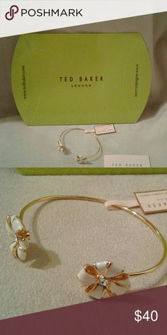 Ted Baker London cuff. Swarovski crystals in detai Ivory and gold Rosette cuff bracelet Jewelry Bracelets