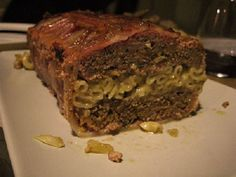 Mac & Cheese Stuffed Meatloaf wraped in bacon
