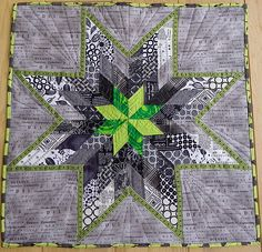 love the colors together - a cool revamping of a traditional pattern.  http://quiltstory.blogspot.com/