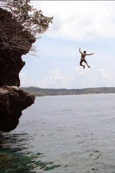 Have courage to jump of the rocks at lake