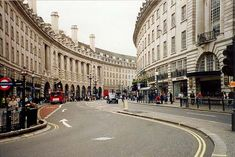 London street. The curve of the street is a visual element in itself, especially compared to the grid-like US. The repetition of windows helps your eye to ove along the street. The archways on the bottom and columns give the architecture an older feeling.