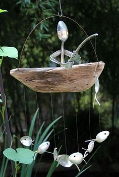 Home of the original spoon fish wind chimes! Features a delightfully charming spoon man fishing atop a natural driftwood dingy. Hanging beneath swims a school of seven silverplated spoon fish. Chime produces a very gentle soothing sound in the breeze. Can also be designed noiseless if desired. ( please send convo with order stating your request) These whimsical wind chimes are up-cycled from vintage & antique silver plated utensils dating back as early as the 1800s. Designed to last ...