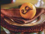 A studded fruit  pomander with monogram