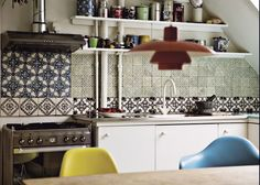 A kitchen backsplash of Made a Mano patchwork tiles from Copenhagen-based; shown here, their Novecento line of lavastone tiles via Remodelista. Home Interior, Kitchen Interior, New Kitchen, Kitchen Decor, Kitchen Design, Awesome Kitchen, Beautiful Kitchen, Interior Design, Cozy Kitchen