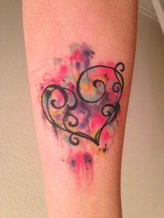 extremely good  heart watercolor tattoo on forearm