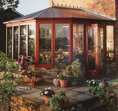 I would love to have a sunroom like this that I could fill with plants and flowers and let all my parrots fly around for exercise in there. Great reading spot :)