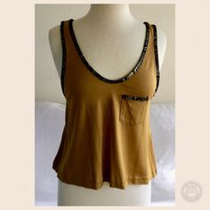 3.1 Phillip Lim Tank Size S.  70 % silk 30% wool.  Mustard colored tank with metallic lizard trim around the low cut neckline, around the armholes and the top of the chest pocket.  In excellent gently used condition.  Negotiable, reasonable offers welcome.  Use the offer button.  No trades/no PayPal. 3.1 Phillip Lim Tops Tank Tops