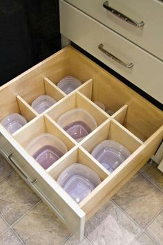 Spacers to corral the storage containers
