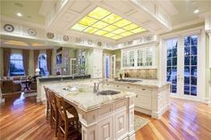 Traditional Kitchen with L-shaped, French doors, Crown molding, Stone Tile, Inset cabinets, Raised panel, Undermount Sink