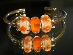 Reminds me of Apricots-a great Bangle design from a Trollbeads Gallery Forum member!  We still have some of the ROYAL ORANGE beads left...but not many! $43 Follow link!  http://www.trollbeadsgallery.com/royal-orange/