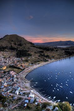 Copacabana, Lake Titicaca, Bolivia  This world is really awesome. The woman who make our chocolate think you're awesome, too. Please consider ordering some Peruvian Chocolate today! Fast shipping! http://www.amazon.com/gp/product/B00725K254