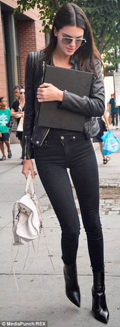 Statuesque: Kendall showed off her lean legs in a pair of black skinny jeans and pointed-t...