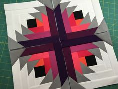 Stunningly vibrant blocks by Judy Niemeyer of Canton Village Quilt Works .
