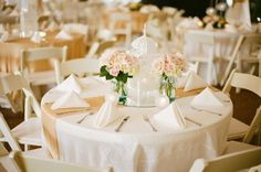 Light pink and ivory flowers with white lantern and gold runner | Photography by michellecrossphotography.com @ riverwoodmansion.com
