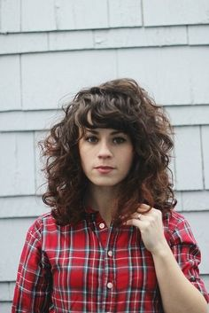 short, midlength, thick curly hair style that actually looks cute!