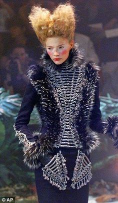 Alexander McQueen - the collar reminds me of the Medici Collar. It does not close all the way around the neck and stands