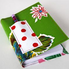 Mini Oil Cloth Notebook Covers!  http://www.skiptomylou.org/2010/12/23/mini-oil-cloth-notebook-covers/