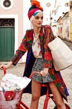 In Living Colour: Our Brazil Fashion Shoot Silk coat, $849, by Roopa Pemmaraju; silk T-shirt, $290, by Romance Was Born; tweed shorts, $369, by Lisa Ho; scarf by Jac+Jack; bag by Hermes; embroidered tablecloth in bike basket) stylist's own.