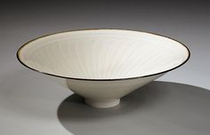 White glazed teabowl with iron-glazed rim and interior incised floral design, 2014 Glazed porcelain 2 1/8 x 6 7/8 in. Inv# 8722 SOLD Image