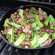 Asian Beef with Snow Peas from Allrecipes.com - make sure to double the sauce, try adding mushrooms, shredded carrots, sweet red peppers