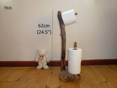 Welcome to Driftwood For The Home  ---Desc---  An unusual and very practical Toilet Roll Dispenser. You can place this item exactly where you want. Very child friendly. No drilling into walls.   ---About my shop--- All driftwood products on this site are hand crafted and are a one off unique product, made from natural driftwood found locally by me while wrecking coves and beaches in West Cornwall.  Each Driftwood part has had a journey by sea which would have originated anywhere in our…