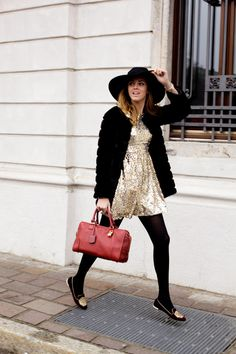Love this glittery, black combination with the big hat and touch of red.