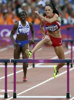 USA's Georganne Moline leads the pack in the women's 400 meter hurdles semifinal at Olympic Stadium during the London 2012 Olympics on Sunday, August 5, 2012 in London.