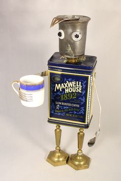 """""""Maxwell"""" ~ Maxwell needs his morning cup of joe to kick start his day! Found object art created by Laurie Schnurer in 2016. To purchase one of Laurie's Creatures go to https://www.facebook.com/LauriesCreatures."""