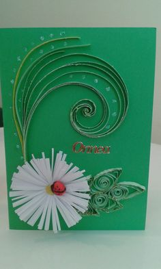 Flower and ladybird by quilling