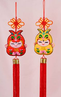 These Chinese New Year decorations are designed with an embroidered greeting children motif. The chubby child cherubs are wearing rabbit hats with the Chinese character Chinese New Year Decorations, New Years Decorations, Chinese Babies, Year Of The Rabbit, Propaganda Art, Baby Embroidery, Rabbit Baby, Valentine Cards, Hanging Art