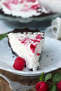 No Bake White Chocolate Raspberry Cheesecake, a frozen, decadent version of a classic cheesecake. With Oreo cookie crust! - ThisSillyGirlsLife.com #OreoCrust #WhiteChocolateRaspberryCheesecake #Cheesecake #NoBake #NoBakeCheesecake