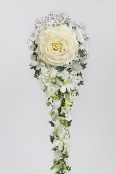 Wedding bouguet, roses, hyacint, denrobium by Saija Sitolahti
