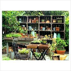 Awesome idea - Shelves made from wooden crates containing containers and other gardening supplies.