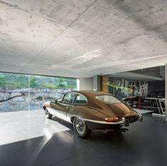 ES1Arq Renovates An 18th-Century Portuguese Farmhouse | The former stable, turned garage, displays a 1964 E-Type Jaguar. #design #interiordesign #interiordesignmagazine
