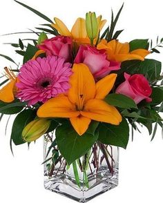 Sweet, reliable blooms of unscented Asiatic Lilies, roses and Gerbera Daisies are precisely arranged in a popular cube style glass vase for days of endless smiles. Spring Flower Arrangements, Vase Arrangements, Floral Centerpieces, Flower Vases, Spring Flowers, Get Well Flowers, Fake Flowers, Small Flowers, Colorful Flowers