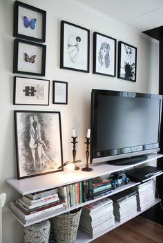 TV gallery wall, clean shelves, realistic bookshelf styling