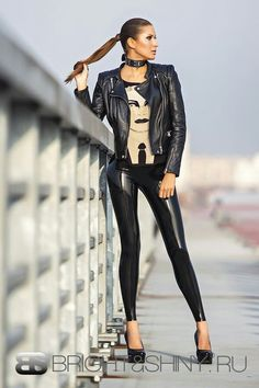 Hot chick wearing latex leggings and leather jacket