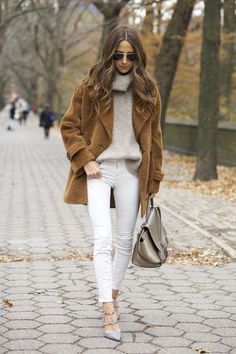 One of our favorite ways of wearing white jeans in the winter is to pair with a ton of camel and cream. Something Navy does the trend beautifully by adding in an oversized turtleneck sweater and a cozy, fuzzy coat.