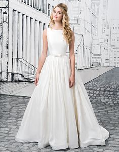 Justin Alexander wedding dresses style 8877 Simplicity at its best is created by this Silk Dupion ball gown with a Sabrina neckline, natural waist, open back with bow closures, and cathedral length train. A Mikado version of this gown is available as style 8877A.