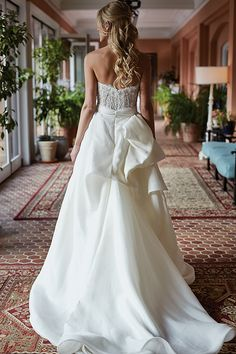 A strapless @mlhuillier wedding dress with a giant back bow | Brides.com