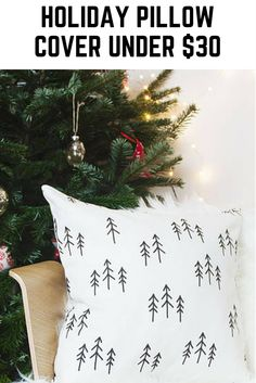 ad: scandinavian holiday pillow cover, white pillow with black trees, love this pattern