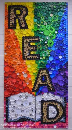 """2012 was the first year my Intermediate school created bottle cap """"murals"""". Some were small, some were m 2012 was the first year my Intermediate school created bottle cap """"murals"""". Some were small, some were medium, but this year we went BIG to. Bottle Top Art, Bottle Top Crafts, Bottle Cap Projects, Plastic Bottle Tops, Plastic Art, Plastic Beads, Collaborative Art Projects, School Art Projects, Diy Recycling"""