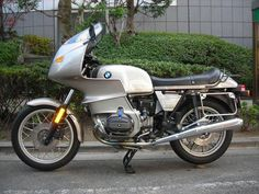 BMW R100RS come in many colours.  This one has the saddle bags removed.  A great bike for the do-it-yourself home mechanic who knows how to use tools and read a manual.