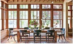 rustic dining area | southernliving nov '13 1. deep seating 2. trestle table 3. wall of windows 4. large-scale lighting 5. exposed beams